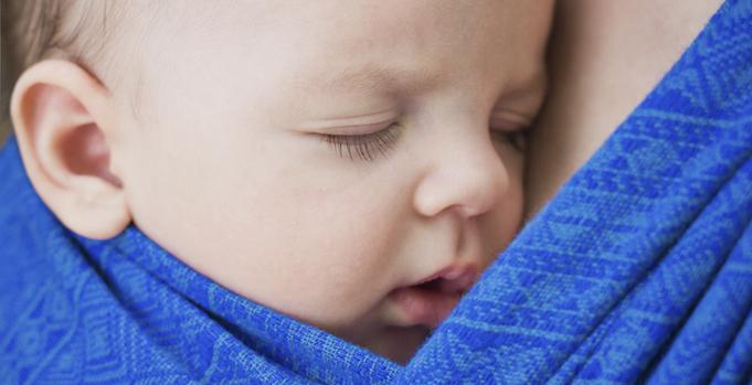 Newborn in baby sling