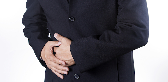 Businessman holding their stomach