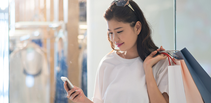 Woman shopping with a mobile phone