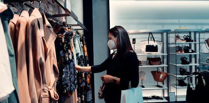 woman wearing face mask shopping